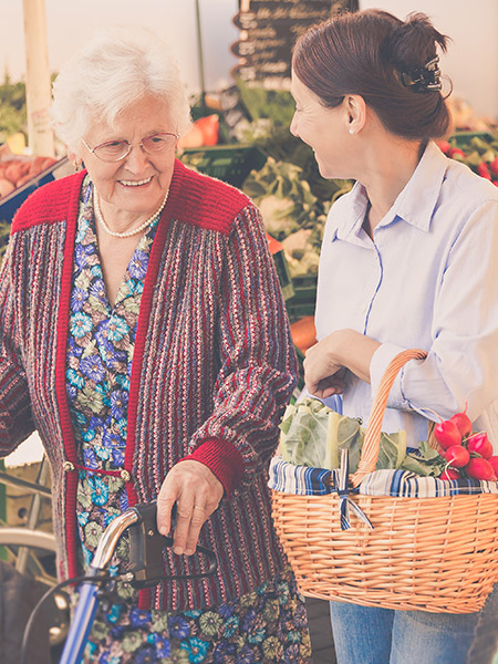 Caregiver and Senior with Groceries