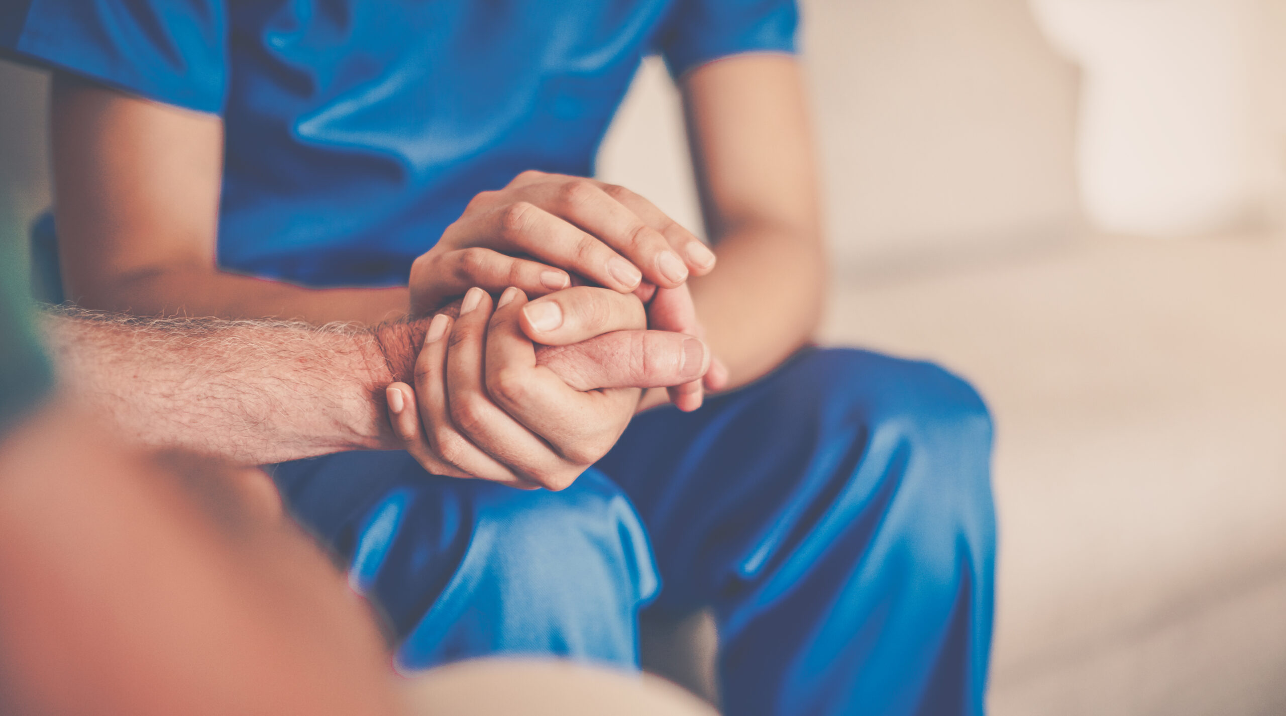 Cropped shot of a female carer consoling a senior patient at the nursing home