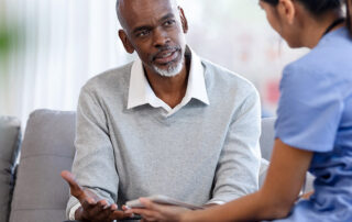 Senior man talking with doctor